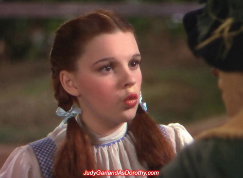 Judy Garland as Dorothy blows the Scarecrow a kiss