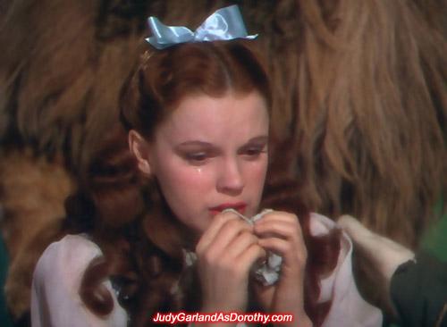 Judy Garland as Dorothy crying at the Emerald City
