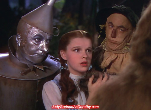 Judy Garland as Dorothy face up to the Cowardly Lion
