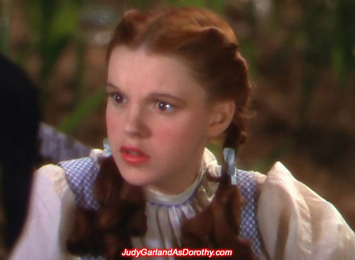 Judy Garland as Dorothy gives a concerned look in MGM's The Wizard of Oz