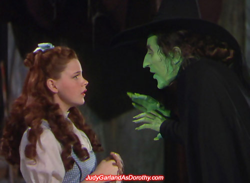 Judy Garland as Dorothy is confronted by the mean Wicked Witch of the West