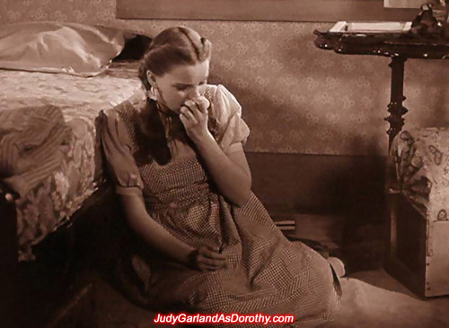 Judy Garland as Dorothy is left in tears inside her bedroom