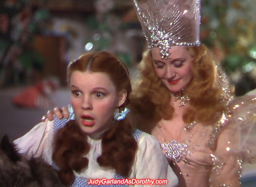 Judy Garland as Dorothy is shocked after Glinda gives her the ruby slippers