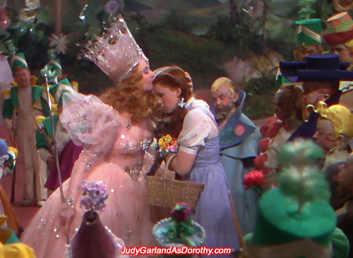 Judy Garland as Dorothy receives a good luck kiss from Glinda