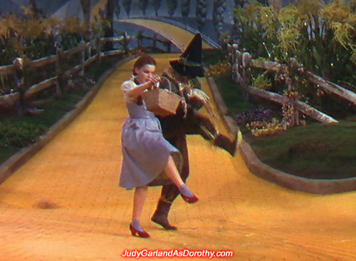 Judy Garland as Dorothy shows off her dancing skills with the Scarecrow