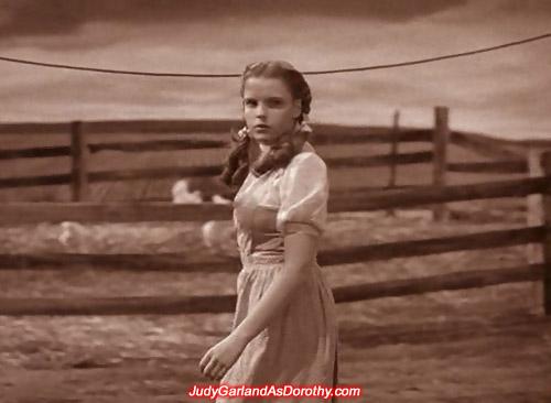 Judy Garland as Dorothy taking a stroll on her Kansas farm