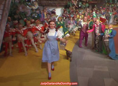 Kansas farm girl Judy Garland as Dorothy skipping down the Yellow Brick Road