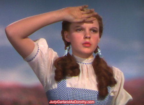 Stunning beauty Judy Garland as Dorothy does the salute