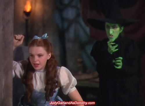 The Wicked Witch of the West keeps a close eye on Judy Garland as Dorothy